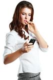 Woman dismayed she sees on phone Royalty Free Stock Photo
