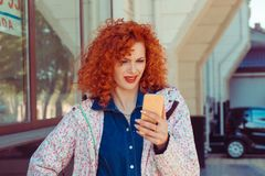 Woman dismayed at something she sees on her cell phone dibelief royalty free stock photos