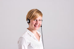 Woman Dispatcher with Intercom. Young Woman Dispatcher with Headset Stock Image