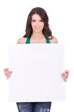 Woman displaying a banner ad. Casual woman displaying a banner ad isolated over a white background stock photography