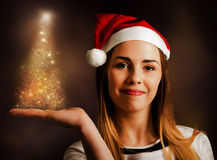 Woman displaying christmas tree lights Royalty Free Stock Image