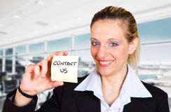 Woman displaying a contact us Royalty Free Stock Image