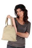 Woman displaying her bag Stock Images