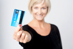 Woman displaying her credit card Royalty Free Stock Photo