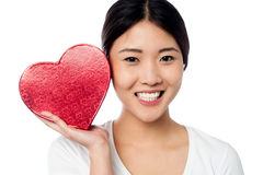 Woman displaying her valentine gift Royalty Free Stock Photos