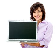 Woman displaying laptop Stock Photo