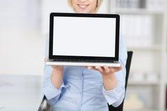 Woman displaying laptop Stock Photo