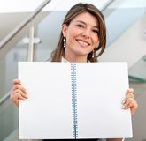 Woman displaying a notebook Stock Image