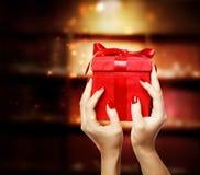Woman Displaying Red Gift Box Royalty Free Stock Photo