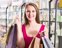Woman  displaying shopping bags with purchase in the natural co Royalty Free Stock Photography