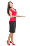 Woman displaying / showing product copy. Woman showing / displaying copy space for your product / message. Isolated full body photo of young beautiful mixed royalty free stock photography