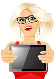 Woman displaying tablet Royalty Free Stock Photography