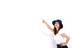 Woman displaying your product. Portrait of cheerful young woman displaying your product over white background Stock Image