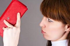 Displeasure looks purse. Woman with displeasure looks purse Royalty Free Stock Photography