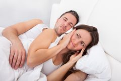 Woman disturbed with man snoring Stock Photo