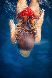 Woman dive. In pool shot from above stock image