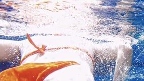 Woman dive underwater in snorkeling diving mask stock video footage