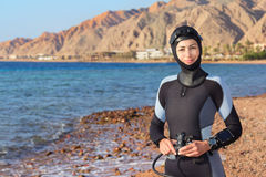 Woman diver. Prepares to dive. Dahab, Red Sea Royalty Free Stock Photography