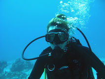 Woman diver. Close up of woman diver under sea Stock Photo