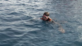 Woman diver dives into flippers underwater in Red Sea. stock video