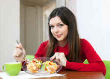 Woman divided lunch for two parts Stock Photography
