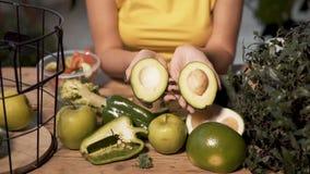 Woman Divides Avocado stock video