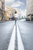 Woman on the dividing strip Royalty Free Stock Photography