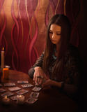 Woman  with divination cards in room Stock Images