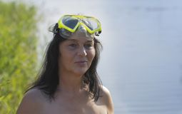 Woman with diving goggles. Portrait of a woman with diving goggles royalty free stock photos