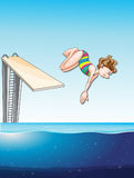 Woman diving in the pool Stock Photos