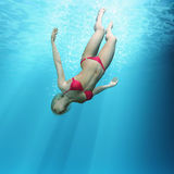 Woman diving in the sea Royalty Free Stock Photo