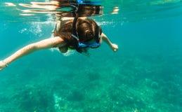 Woman diving or snorkelling in ocean Stock Photos
