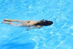 Woman diving underwater Stock Photo