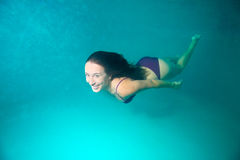 Woman diving underwater Royalty Free Stock Photo