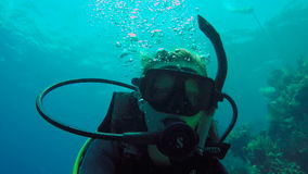 Woman diving in Utila closeup selfie stock footage