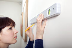 Woman DIY Spirit Level Royalty Free Stock Photo