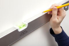 Woman DIY Spirit Level Stock Photo