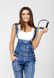 Woman DJ with earphones in jeans and white shirt Royalty Free Stock Images