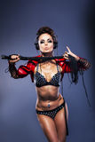 Woman dj in lingerie holding whip with headphones Stock Photos
