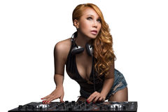 Woman DJ mixes the track in the nightclub. Royalty Free Stock Photography