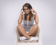 Woman dj wearing retro headphones Royalty Free Stock Photos