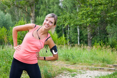 Woman do exercises outdoor. Royalty Free Stock Photography