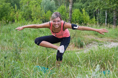 Woman do exercises outdoor. royalty free stock image