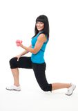Woman do fitness stand with dumbbells Royalty Free Stock Photography