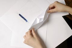 Hand crafted paper boat. Woman do origami boat from paper sheet Royalty Free Stock Image