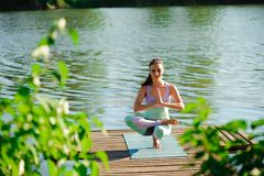 Woman do yoga outdoor. Woman exercising vital and meditation for fitness lifestyle club at the nature background stock photos