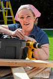 Woman do it yourself project. Mature woman with tools and toolbox ready to start work Stock Photo