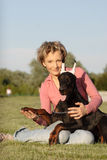 Woman with doberman puppy Royalty Free Stock Image