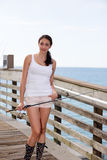 Woman on the dock with a fishing pole Royalty Free Stock Photography