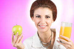 Woman doctor with apple and juise orange Stock Image